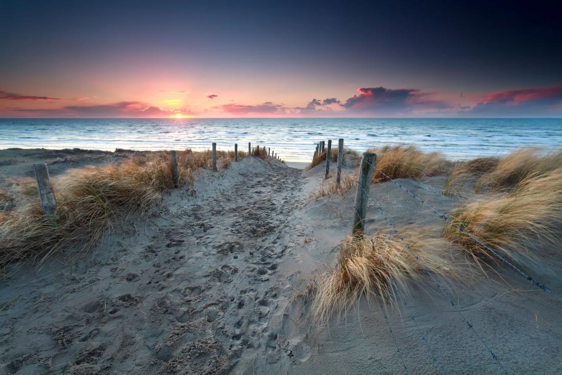 Fotokunst zonsondergang aan het strand 75x100